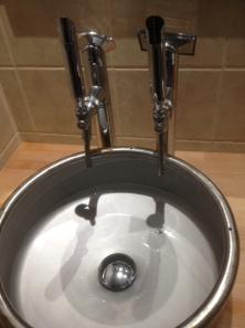 barrel sink with pumps for taps